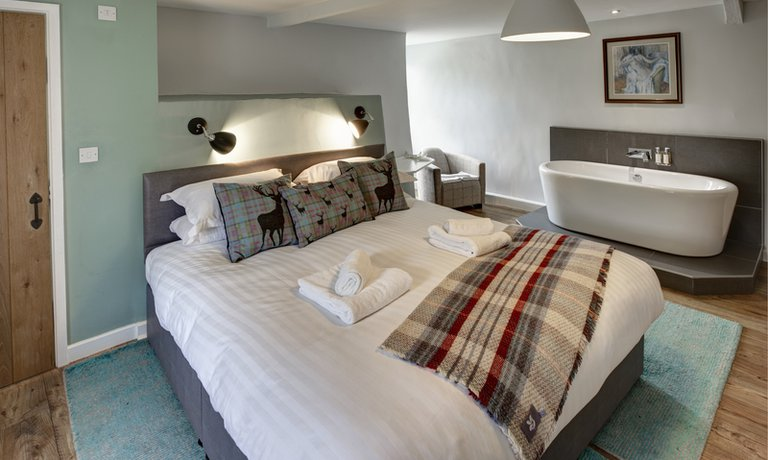 Sumptuous king-size bed in double bedroom