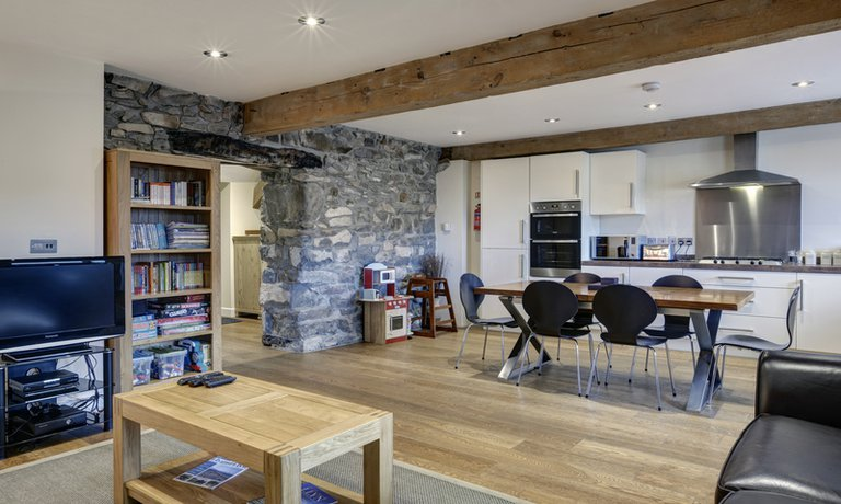 Showcasing an abundance of rustic features including wooden beams
