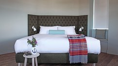 Plush bed with local furnishings
