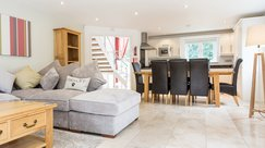 Open plan living area with plush furnishings