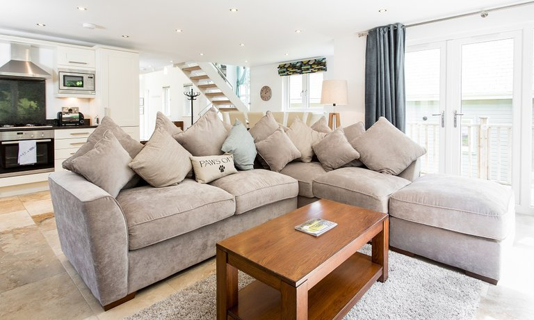 Large, plush sofa in open plan living space