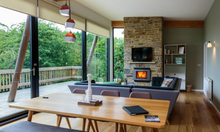Open plan living area with log-burning fire
